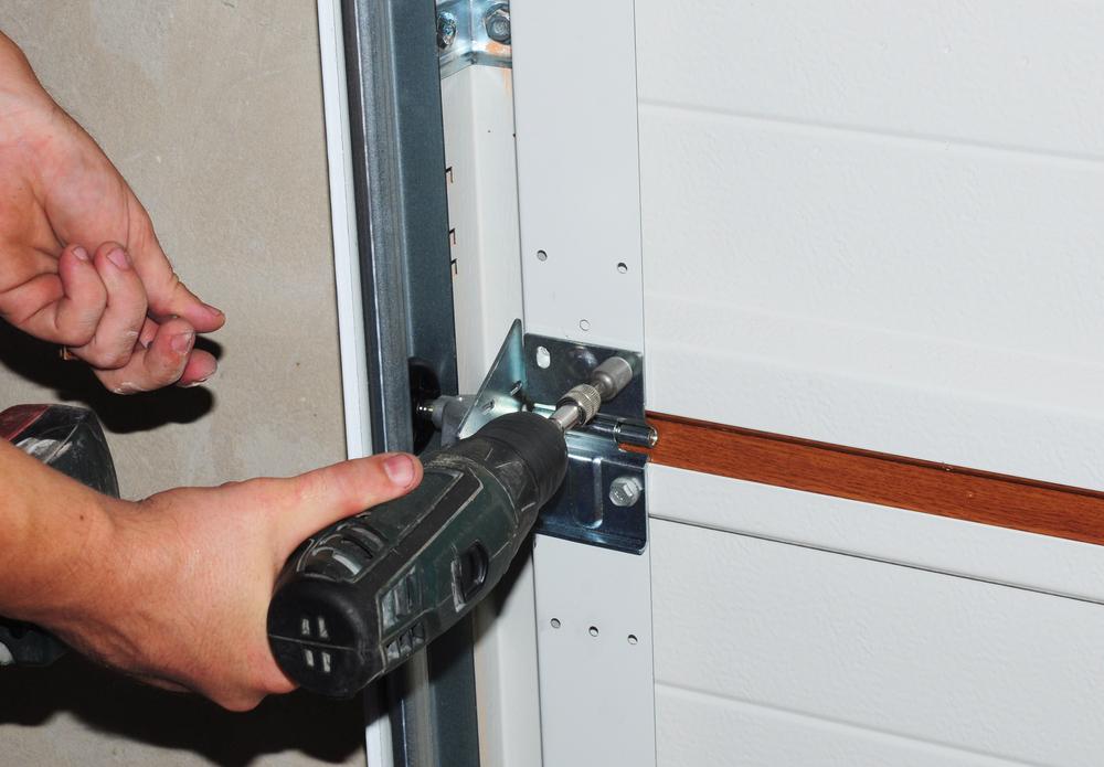 Contractor repair and replace garage door. Garage door installation